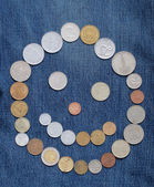 Smile from coins on blue — Stock Photo