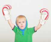 Winner boy with boxing gloves — Stock Photo