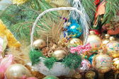 Pannier with Christmas decorations — Stock Photo