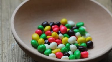 Colored candies in a dish — ストックビデオ