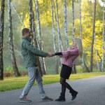 Couple in autumn park — Stock Photo #73495077