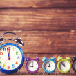 Retro alarm clocks on a table. Photo in retro color image style — Stock Photo #51926169