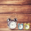 Retro alarm clocks on a table. Photo in retro color image style — Stock Photo #51926171