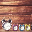 Retro alarm clocks on a table. Photo in retro color image style — Stock Photo #51926183