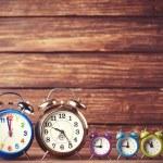 Retro alarm clocks on a table. Photo in retro color image style — Stock Photo #51926185