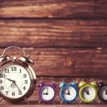 Retro alarm clocks on a table. Photo in retro color image style — Stock Photo #51926191