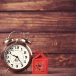 Retro alarm clock and holidays gift — Stock Photo #51926193