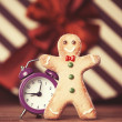Cookie man and alarm clock — Stock Photo #51926359