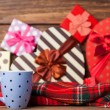 Winter tea in a cup and christmas gifts on background. — Stock Photo #51926375