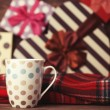 Winter tea in a cup and christmas gifts on background. — Stock Photo #51926385