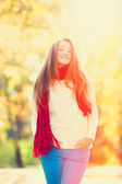 Teen girl in red scarf at autumn outdoor — Stock Photo