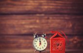 Retro alarm clock and holidays gift — Stock Photo