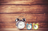 Retro alarm clocks on a table. Photo in retro color image style — Stock Photo