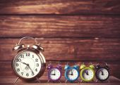 Retro alarm clocks on a table. Photo in retro color image style — Stock Photo