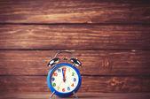 Retro alarm clock on wooden background — Stock Photo