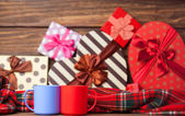Two cup of coffee and holidays gifts on background. — Stockfoto