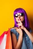 Women with violet hair with shopping bags. — Stock Photo