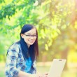 Teen girl with laptop in the park. — Stock Photo #52242651