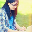 Teen girl with laptop in the park. — Stock Photo #52242735