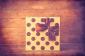 Retro gift on wooden table. — Stock Photo