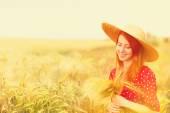 Redhead girl in red dress at wheat field — Foto de Stock