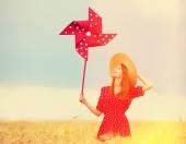 Redhead girl with toy wind turbine — Stock Photo
