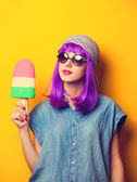Beautiful girl with violet hair in sunglasses and ice-cream on y — Stock Photo
