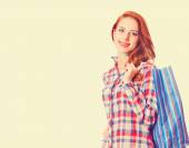 Woman holding shopping bags and smiling — Stock Photo