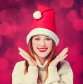 Redhead girl in christmas hat — Stock Photo