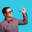 Nerd with pen and glasses on blue background. — Stockfoto #52839703