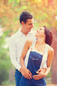 Teen couple in the park in autumn time — Stock Photo