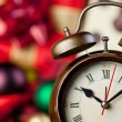 Alarm clock and christmas gifts on background. — Stock Photo #56532405