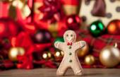 Cookie man and christmas gifts — Stock Photo