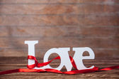 Word Love and stripes on a table. — Stock Photo
