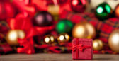 Gift box and christmas gifts on background. — Stock Photo