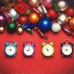 Four clocks near christmas gifts. — Stock Photo #57177363