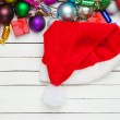 Santas hat near christmas toys. — Stock Photo #57177543