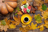 Cup of coffee and heart shape cookies on autumn background. — Stock Photo