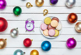 Clock and cookies with christmas toys. — Stock Photo