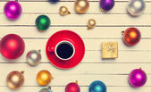 Christmas gifts toys and cup of coffee with gift. — Stock Photo