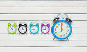 Five alarm clock on white background. — Stock Photo