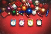 Four clocks near christmas gifts. — Stock Photo
