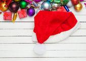 Santas hat near christmas toys. — Stock Photo