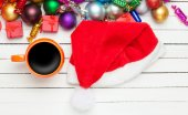 Cup of coffee and christmas toys on white table. — Stock Photo