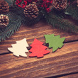 Three christmas tree toys on wooden table. — Stock Photo #57597887