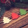 Three christmas tree toys on wooden table. — Stock Photo #57597905