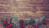 Pine branches on a wooden table. — Stock Photo