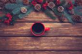 Hot coffee on wooden table near pine branches — Stock Photo