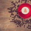 Cup of coffee with shape heart on a wooden table. — Stock Photo #58292195