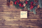 Gift box with pine branches on a wooden table. — Stock Photo